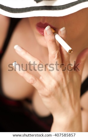 woman with hat and cigarette on white background - stock photo