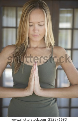 Woman with Head Bowed in Meditation - stock photo