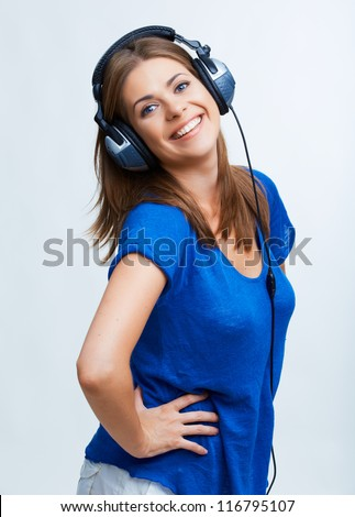 Woman with headphones listening music .Music teenager girl dancing against isolated white background - stock photo