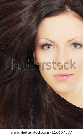 Woman with healthy brown hair - stock photo