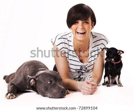 Woman with her dogs chihuahua and English Staffordshire - stock photo
