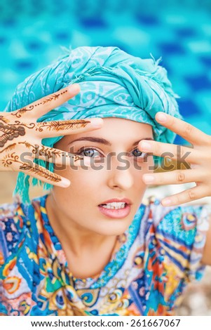 Woman with her hands painted with henna - stock photo