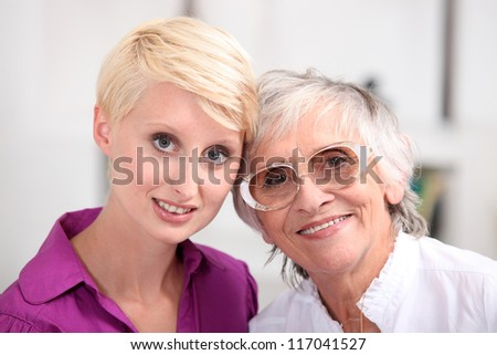 Woman with her mother - stock photo