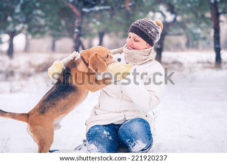 Woman with her pet has winter active leisure time - stock photo