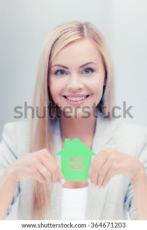 woman with illustration of eco house - stock photo