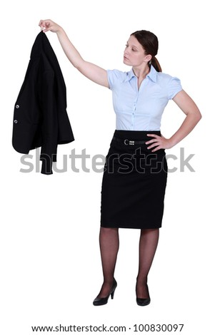 Woman with jacket in hand - stock photo