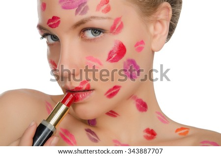 woman with kisses on face holding lipstick isolated on white - stock photo