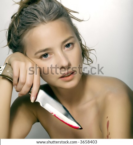 woman with knife - stock photo