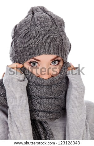 woman with knitted hat and scarf, white background - stock photo