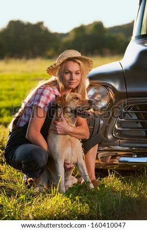 Woman with labrador dog - stock photo