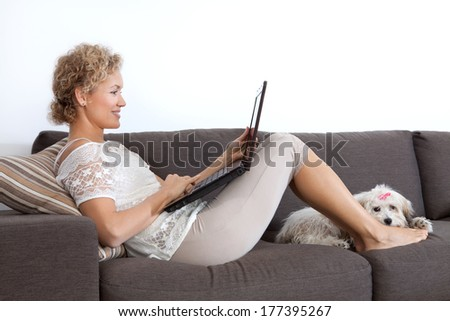 Woman with laptop  - stock photo
