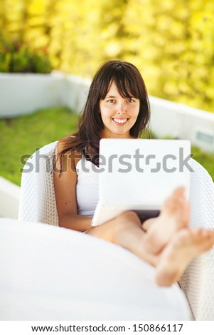 woman with laptop in garden - stock photo