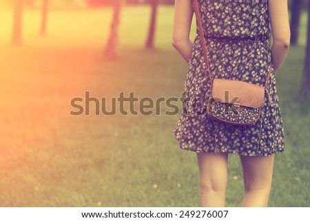 Woman with leather bag - stock photo