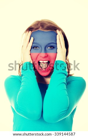 Woman with Liechtenstein flag painted on face. - stock photo