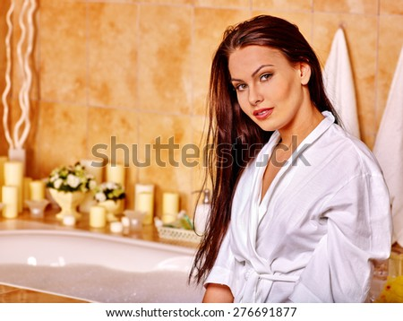 Woman with long hair relaxing at home luxury bath. - stock photo