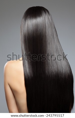 Woman with long straight shiny luxurious hair - stock photo