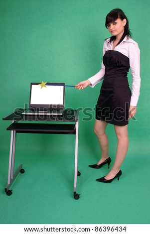 Woman with magic wand and laptop with blank screen. - stock photo