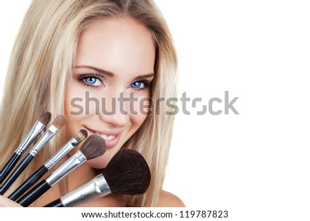 woman with makeup brushes - stock photo