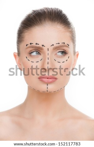 Woman with markings on face. Portrait of beautiful young woman with markings on face isolated on white - stock photo