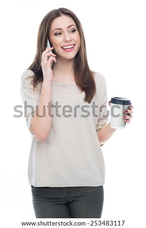 Woman with mobile phone and coffee  - stock photo