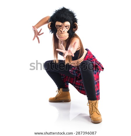 Woman with monkey mask dancing - stock photo