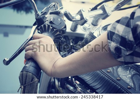 Woman with motorcycle - stock photo