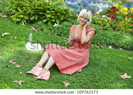 woman with mp3 player listen music outside - stock photo
