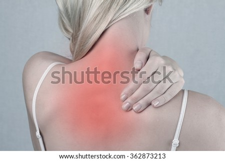 woman with neck and back pain. woman rubbing painful back close up. Pain relief concept - stock photo