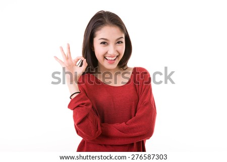 Woman with ok hand sign - stock photo