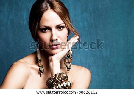 woman with oriental jewelry portrait, studio shot - stock photo
