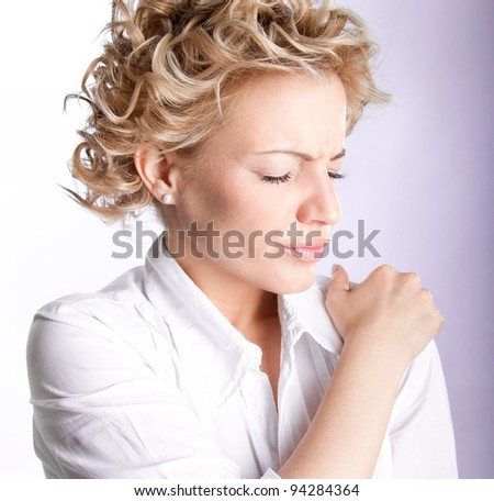 Woman with pain in her shoulder, Isolated medical shot over white background - stock photo
