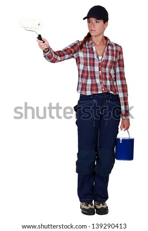 Woman with paint  pot and roller brush - stock photo