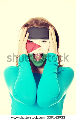 Woman with Palestine flag painted on face. - stock photo
