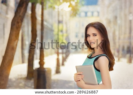 Woman with Pc Tablet Out in the City - Portrait of a businesswoman holding a tablet  - stock photo
