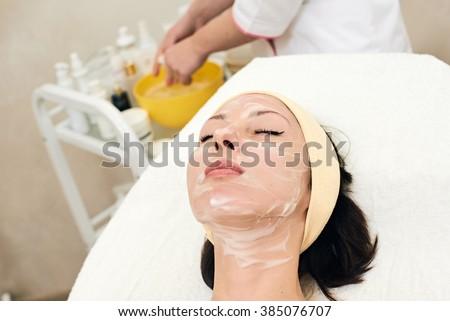 woman with peeling mask - stock photo