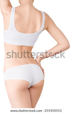 Woman with perfect slim body sideways posing in white underwear isolated on white background. Healthcare, bodycare concept without face - stock photo