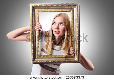 Woman with picture frame on white - stock photo