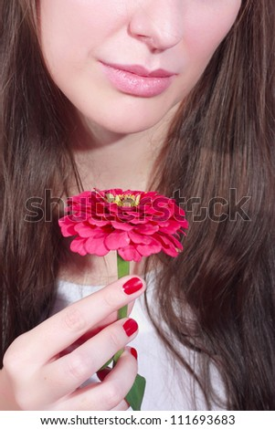 Woman with pink flower - stock photo