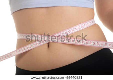 Woman with pink measure tape a over white background - stock photo