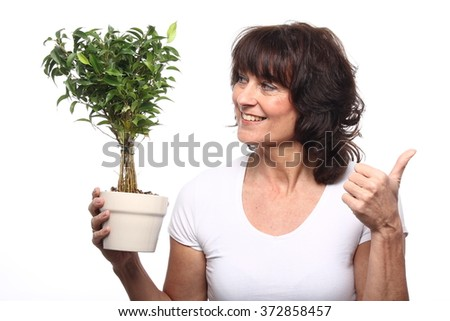 Woman with plant - stock photo