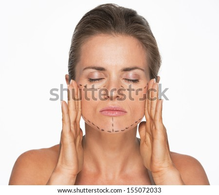 Woman with plastic surgery marks on face - stock photo