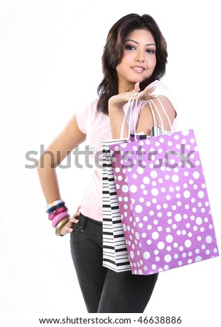 Woman with purple color shopping bag - stock photo
