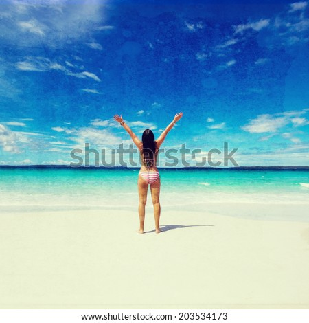 woman with raised hands on the beach. vintage effect - stock photo