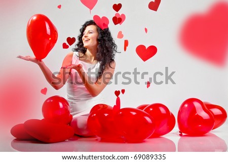 woman with red heart balloon on a white background - stock photo