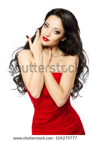 Woman with red lips and dress, long curly hairs over white background. Beautiful close up portrait. - stock photo