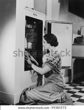 Woman with refrigerator - stock photo