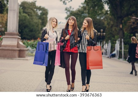 woman with returns from shopping with colored bags fashion - stock photo