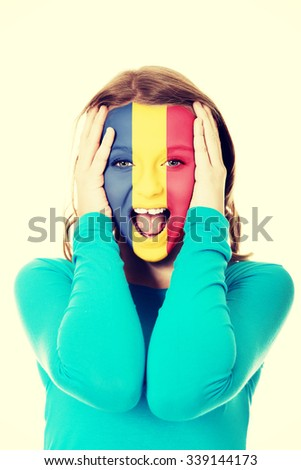 Woman with Romania flag painted on face. - stock photo