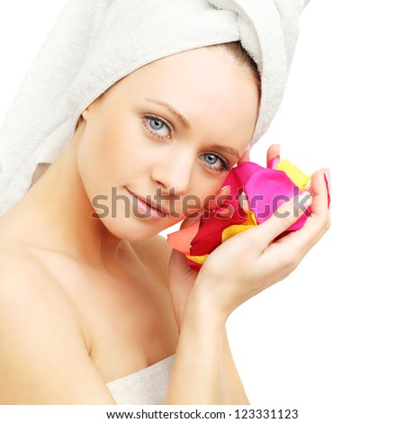 Woman with rose petals - skin care - stock photo
