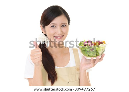 Woman with salad - stock photo